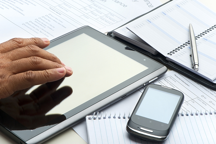 Hand typing on a digital tablet